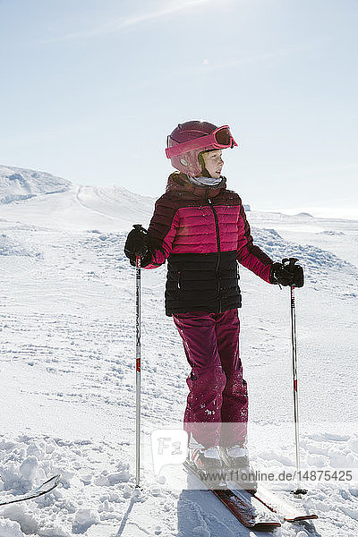Girl skiing in mountains
