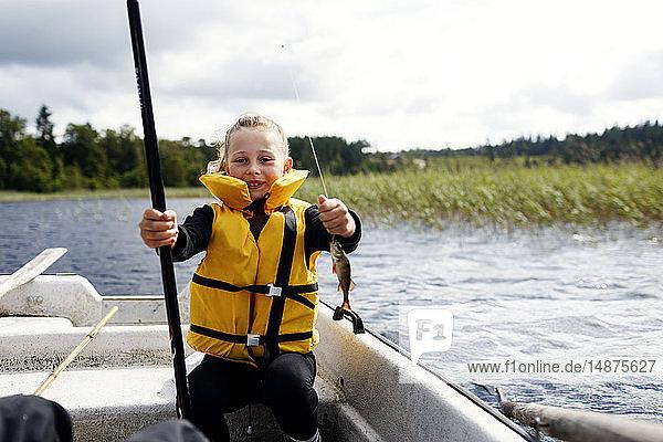 Boy fishing on lake