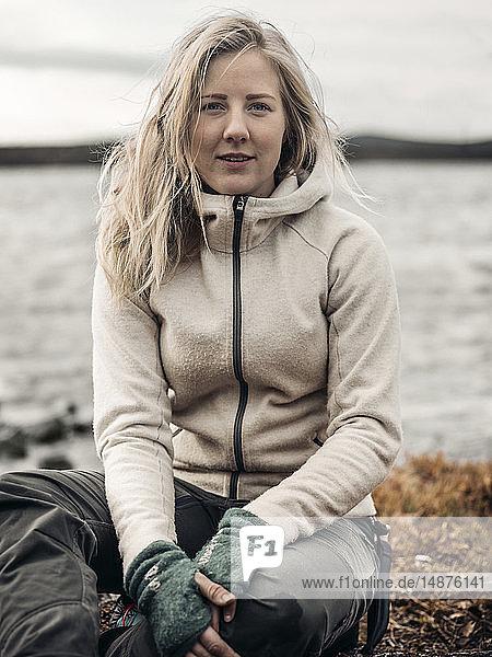 Portrait of woman by lake