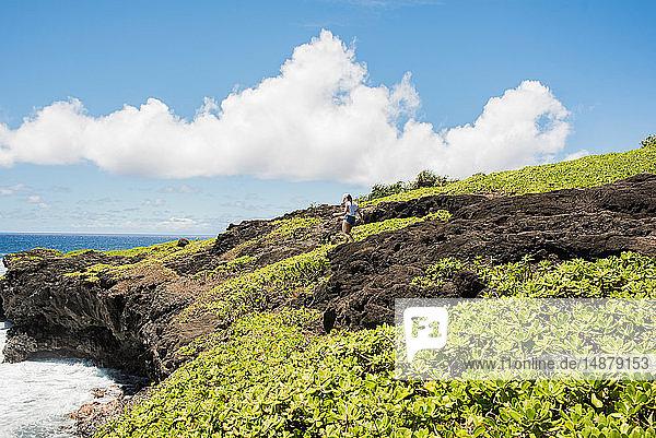 Hiker on coast  Waipipi Trail  Maui  Hawaii