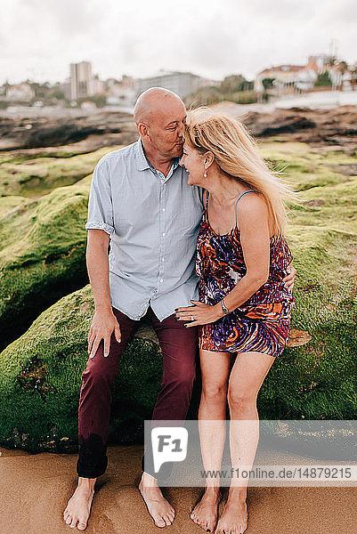 Man kissing woman's forehead on beach  Estoril  Lisboa  Portugal