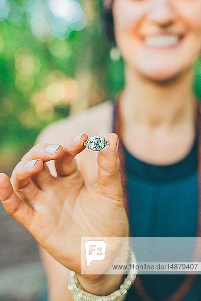 'Woman holding ring with words ''Love the Life you Live'''