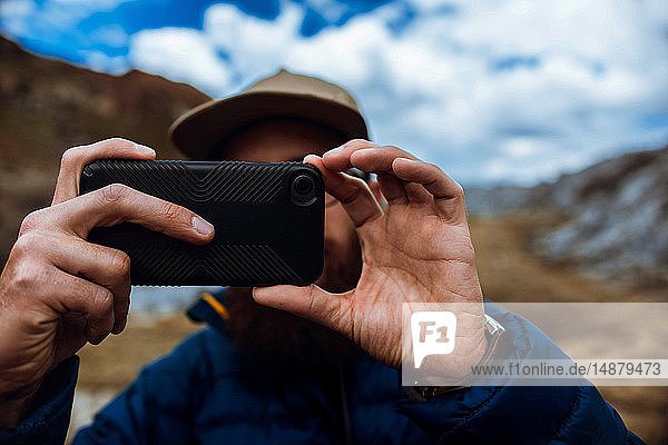 Hiker taking picture with phone  Mineral King  California  United States