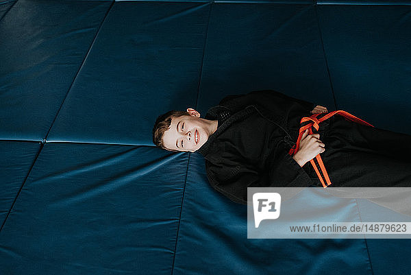 Boy resting in martial arts studio