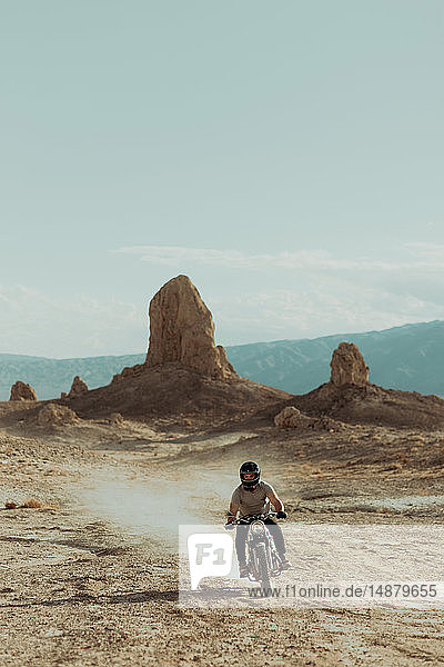 Motorcyclist riding in desert  Trona Pinnacles  California  US