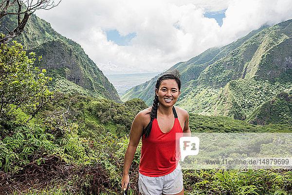 Hiker enjoying rainforest  Iao Valley  Maui  Hawaii