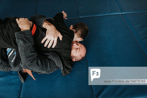 Coach and student wrestling in studio