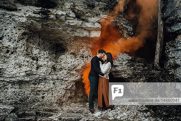 Couple hugging beside rock face  Tobermory  Canada