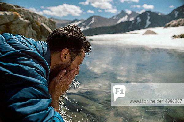 Hiker freshening up at lake  Mineral King  California  United States