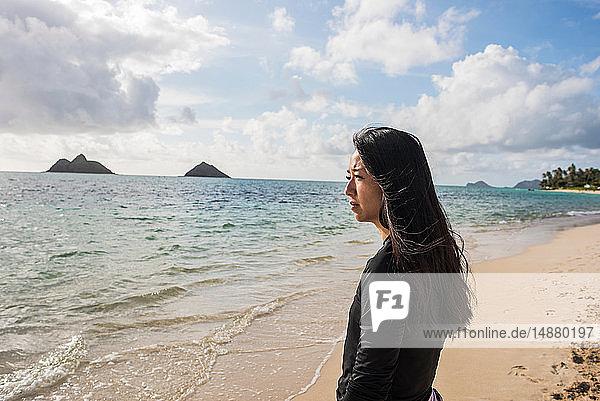 Woman looking out to sea  Lanikai Beach  Oahu  Hawaii
