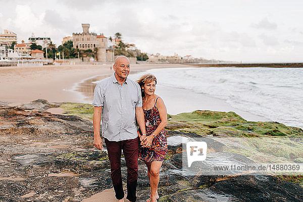 Couple taking walk on beach  Estoril  Lisboa  Portugal