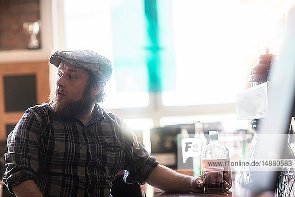 Male customer looking over his shoulder in traditional Irish public house