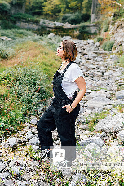 Woman standing in dry riverbed  Rezzago  Lombardy  Italy