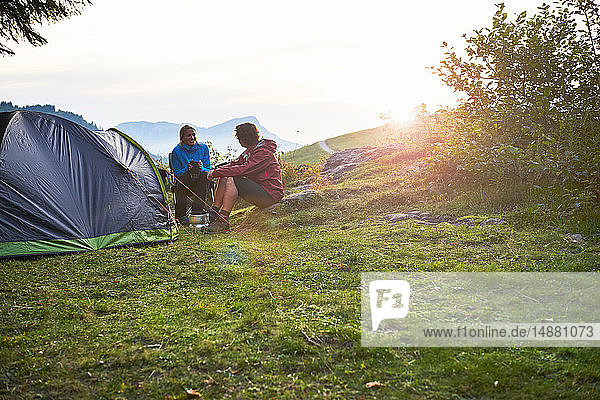 Hikers relaxing by tent  Manigod  Rhone-Alpes  France