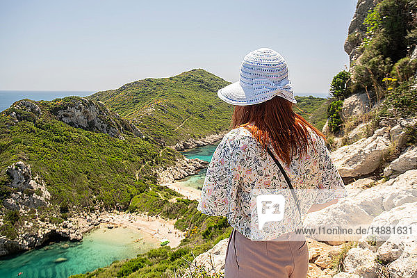 Tourist enjoying view on cliff top  Porto Timoni beach  Corfu  Kerkira  Greece