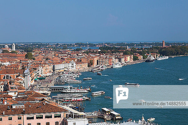 Water taxis and vaporettos along Riva degli Schiavoni promenade  old Renaissance architectural style residential buildings and palaces  Venice  Veneto  Italy