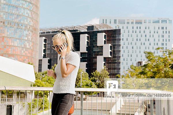 Woman using smartphone in city  Barcelona  Catalonia  Spain