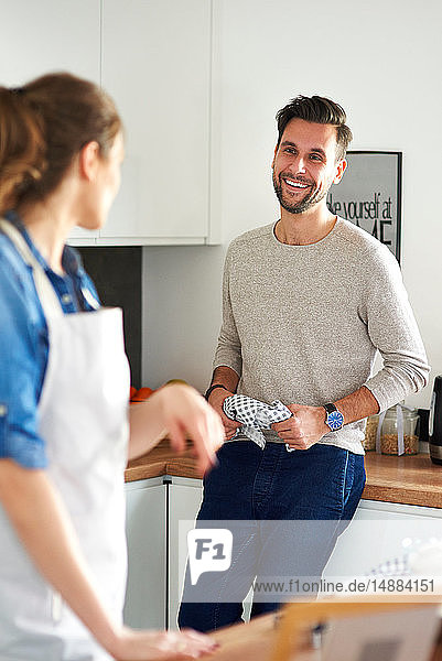 Couple talking in kitchen