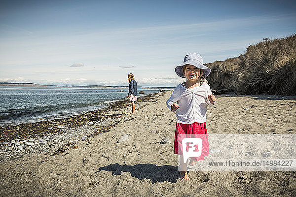Cute girl in sunhat on beach  portrait  Port Townsend  Washington  USA