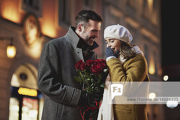Man giving his girlfriend bunch of red roses on Valentine's Day
