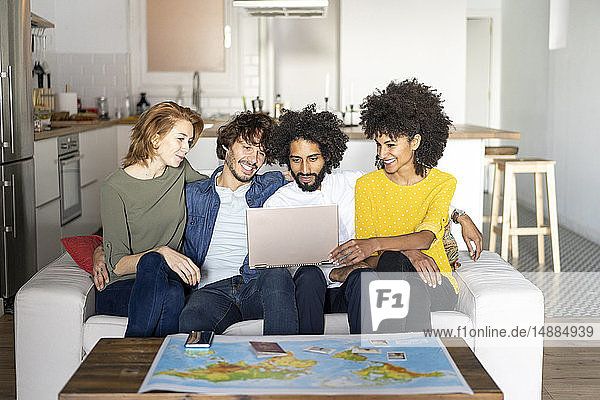 Friends meeting to plan vacations  checking map