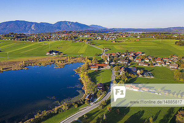 Germany  Upper Bavaria  Alpine foreland  Aerial view of Froschhausen  Froschhauser See  Murnau at Staffelsee in the background