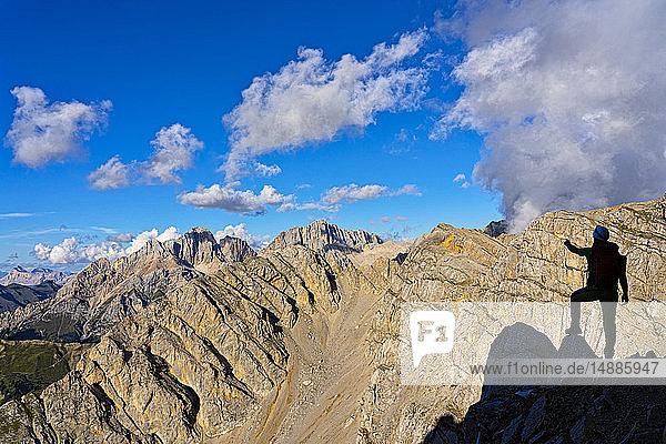 Italy  Veneto  Dolomites  Alta Via Bepi Zac  mountaineer standing on Costabella mountain