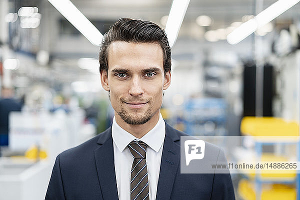 Portrait of confident businessman in a factory