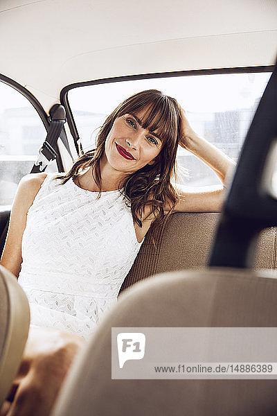 Beautiful woman sitting in vintage car