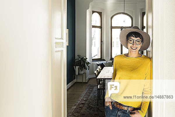 Portrait of smiling stylish woman at home
