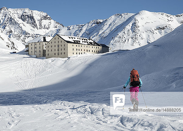 Switzerland  Great St Bernard Hospice  woman ski touring in the mountains