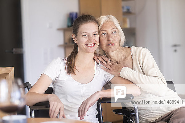 Mother with daughter in a wheelchair