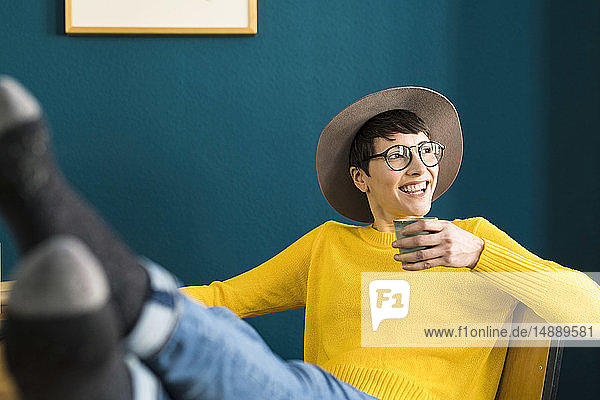 Portrait of happy relaxed businesswoman in home office
