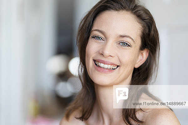 Portrait of laughing woman with brown hair