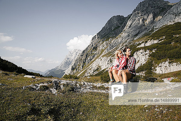 Austria  Tyrol  mother with daughter resting in mountainscape