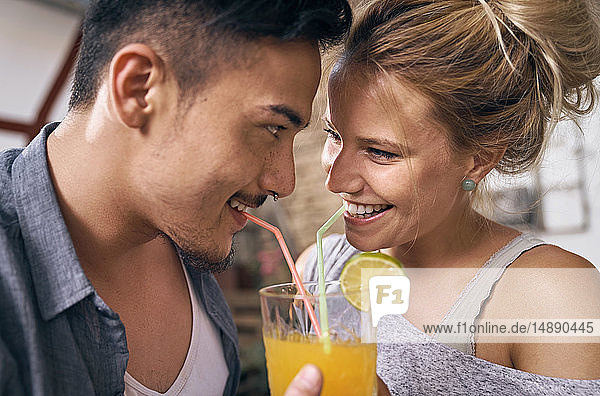 Young couple drinking cool lemonade in a backyard