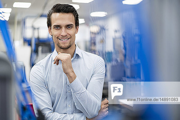 Portrait of smiling businessman in a factory