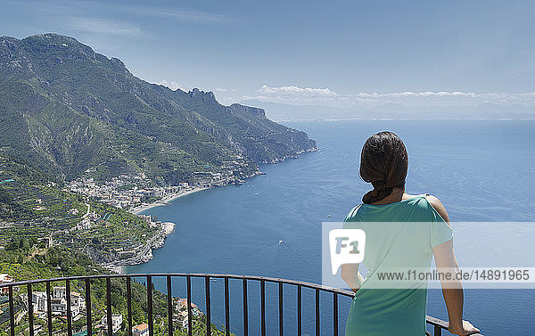 Woman leaning on railing by Amalfi Coast  Italy
