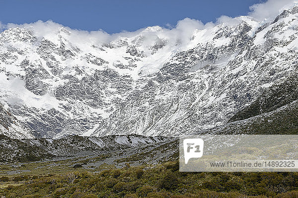 Cloud over snowcapped mountains in Mount Cook National Park  New Zealand