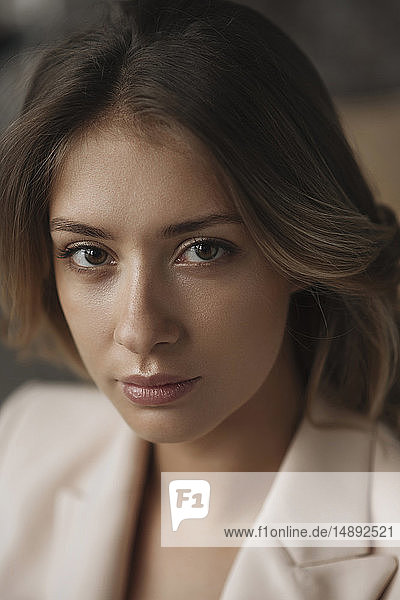 Portrait of young woman wearing natural make-up