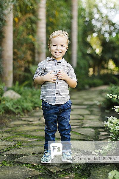 Smiling boy standing in garden