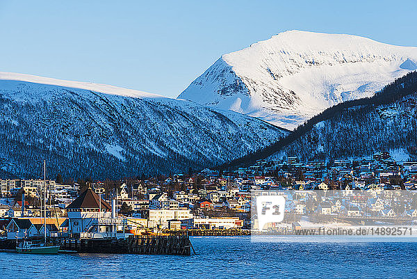 Town under snow covered mountains in Tromso  Norway