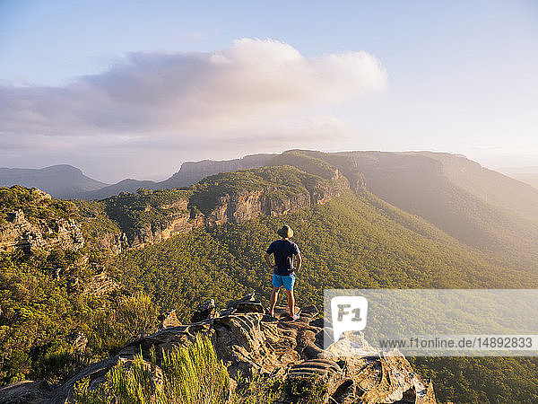 Man standing on peak of Blue Mountains in New South Wales  Australia