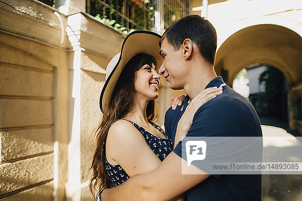 Young couple embracing in courtyard