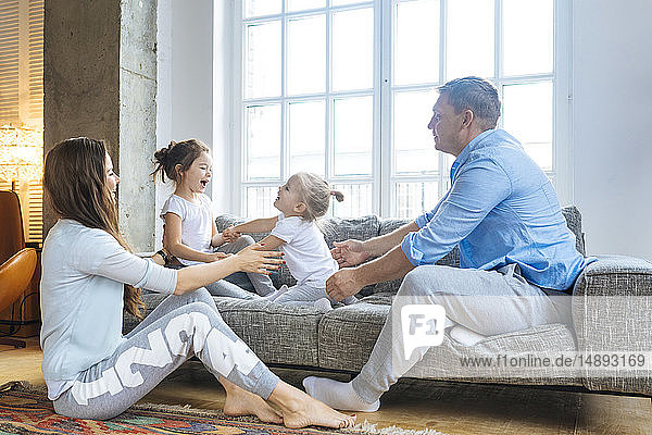 Family playing on sofa