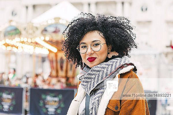 Portrait of young woman wearing glasses and red lipstick