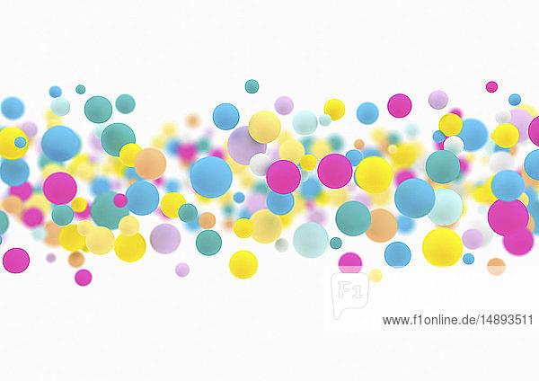 Viele farbenfrohe schwebende Kugeln