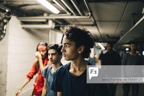 Male friends walking in basement