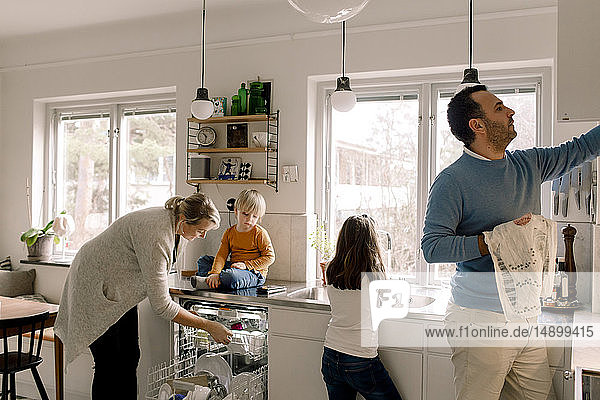 Family working in kitchen at home
