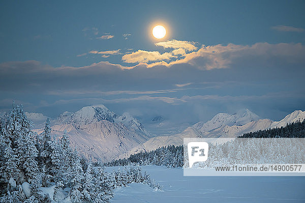 Scenic view of the Super Blood Moon before the eclipse over the Chugach Mountains in Turnagain Pass  South-central Alaska; Alaska  United States of America